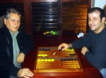 Spyros Peter Goudas and *** playing a game of backgammon (Tavli in Greek).